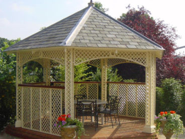 <p>An outdoor dining Gazebo at an hotel, under a bespoke slate roof, with side fence panels, all in a delightful shade of cream.</p>