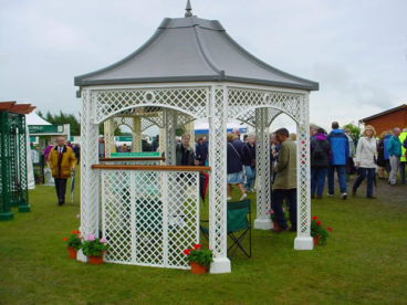 <p>Our display Gazebo at the RHS Tatton Park Flower Show a few seasons ago. It has a faux-lead roof above the lattice columns and side panels.</p>