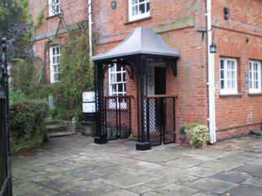<p>A faux-lead, lattice-style Porch, incorporating quarter arches and side panels.</p>