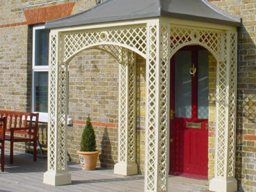 <p>Another cream-coloured Porch with our faux-lead roof, with full-width arches.</p>
