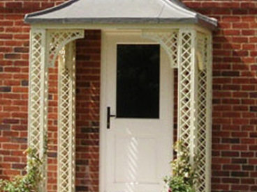 <p>A Quarter-arched Porch in our Lattice style, using our faux-lead roof.  Powder coated in cream.</p>