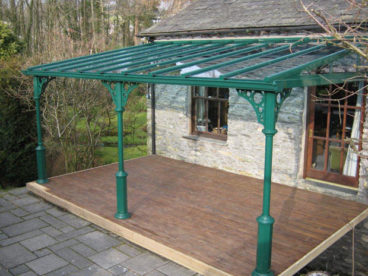 <p>A V8 style verandah with glazed gable ends located on a first floor decked area, in an unusual shade of green. </p>