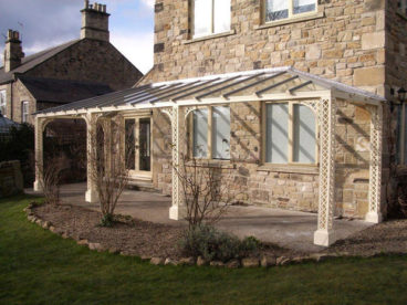 <p>This is a Lattice style Verandah, finished in a beautiful cream shade that blends perfectly with the natural stonework of the house.</p>