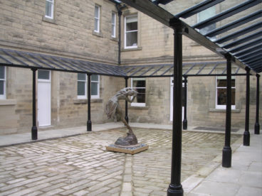 <p>A fantastic restoration of an original Verandah in Derbyshire, 3 sides of a courtyard with re-constructed columns used with our standard roofing system; approximately 37 m long x 2.25 m deep. Fitted 2009</p>