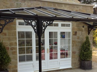 <p>A beautiful hipped verandah using our Royale columns and circles quarter arches, finished in black.</p>