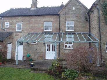 <p>A 6.5m x 2.8m Lean-to Verandah in Derbyshire, set upon a split-level patio.</p>