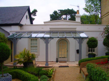 <p>A Verandah on a beautiful Georgian single-storey connecting walkway in Kent; standard lattice columns with Quarter arches; 6 x 2m. Fitted 2010</p>