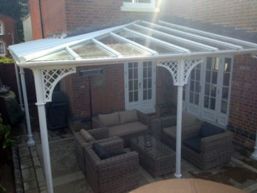 "<p>An ""L"" shaped Verandah in Essex, with a hipped corner, 6.8m x 1.2deep x 4.4 x 3.5m deep; Fluted columns and Trompette bases, with Lattice quarter arches. Fitted 2013</p>"