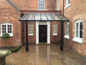 <p>An impressive covered entrance at a grand guest house using our whitworth columns</p>