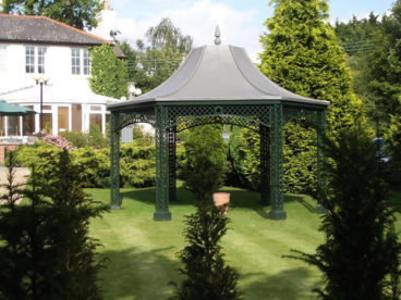 <p>This hexagonal gazebo/smoking shelter blends well with the garden.</p>