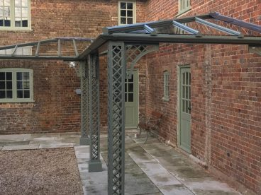 "<p>Using our Lattice columns, this ""L"" shaped hipped Verandah, also has one of our Traditional Benches painted to match for our well-known clients in Dorset, completed 2019.</p>"