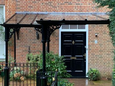 <p>A challenging design for a member of a European Royal family living in Surrey, completed in 2018. Using our V8 columns with circles quarter arches, finished in black. </p>