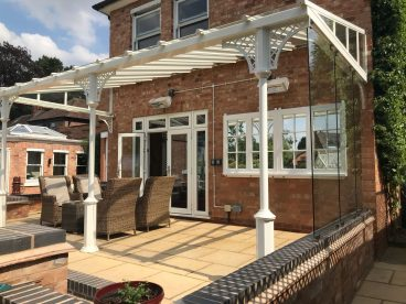 <p>Completed in summer 2018, this verandah has our toughened glass screens to one side. Finished in cream, using our V8 columns with lattice quarter arches. </p>