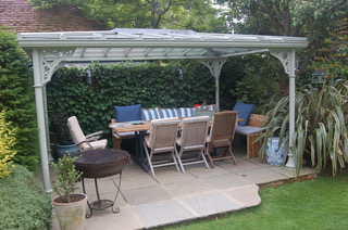 <p>A simple structure with four columns offers an outside dining area in any part of the garden</p>