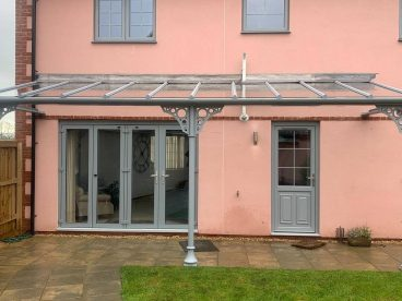 <p>This installation, using trumpet columns with circles quarter arches was completed in January 2021 near Bristol. Finished in RAL7001 to match the doors and windows on the property. </p>